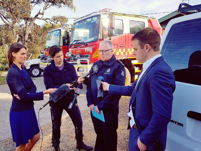 Reporters speak to police about the disappearance of mum Elisa Curry. Picture: Supplied.