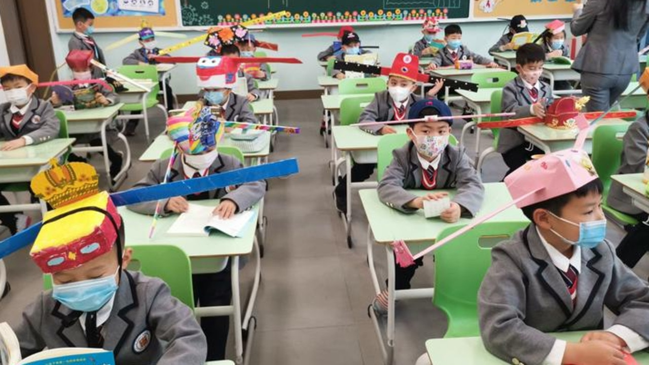 Children return to school in China wearing hats to help social distancing  during COVID-19 pandemic | KidsNews