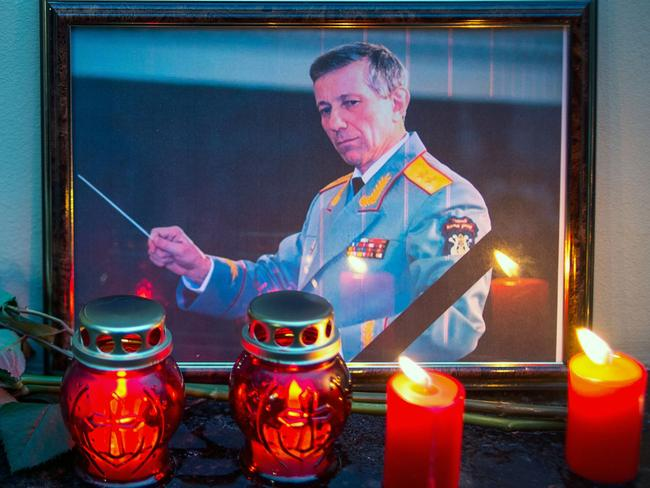 A photo of Valery Khalilov, chief conductor and artistic director of Alexandrov song and dance ensemble, is placed next to candles at the home stage building of the Alexandrov Ensemble (The Red Army Choir), in Moscow. Picture: AFP