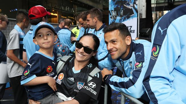 Bobo of Sydney FC has a photo with a fan during A-League champions Sydney FC's fan parade. Picture: Brett Costello