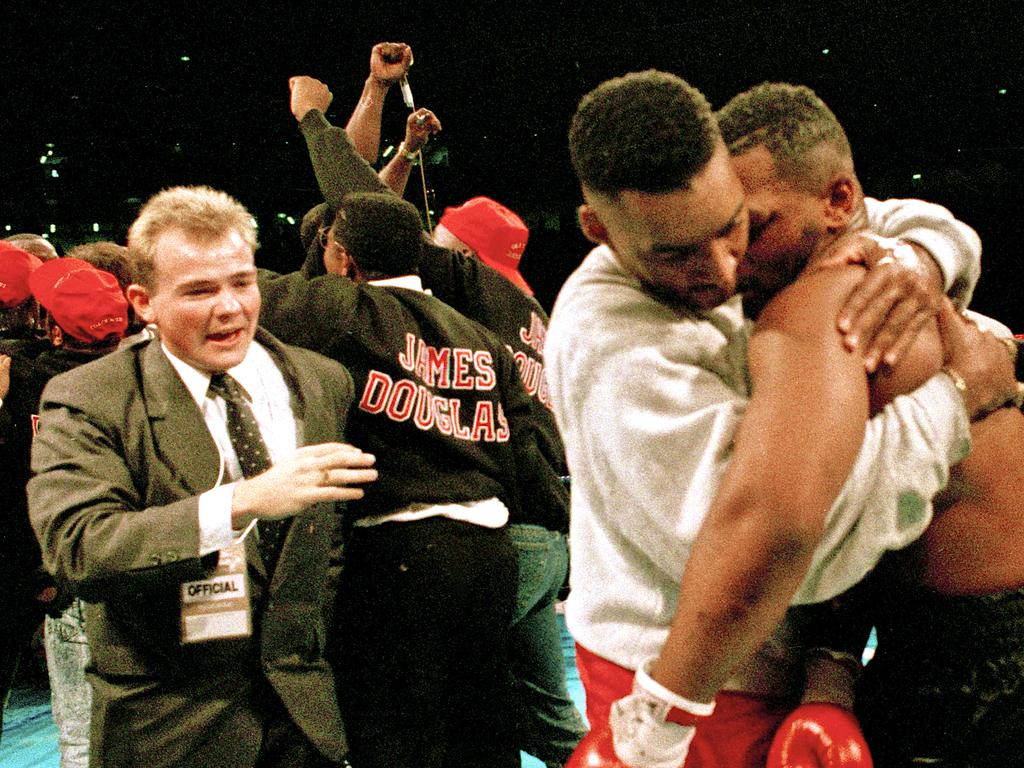 Buster Douglas and Mike Tyson after their world heavyweight title fight.
