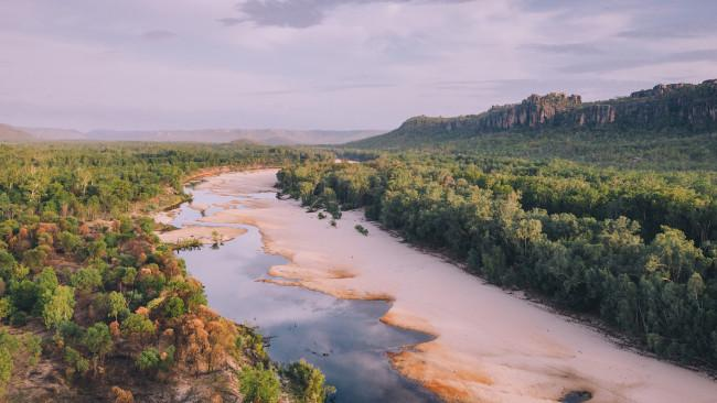 70/71Arnhem Land - Northern Territory In the north-eastern corner of the state is a landscape of epic beauty that is accessible by invite only. If you want the chance to see the wetlands, savannah, beaches and rainforest of Arnhem Land - which has the Yolngu People as traditional owners - you'll need a permit.Picture: Tourism NT/Rachel Stewart