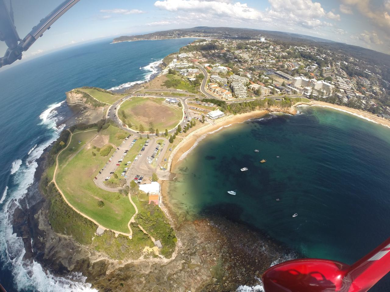 Flying high above Terrigal, on the Central Coast, with Microlight Adventures. Picture: Jennifer Ennion