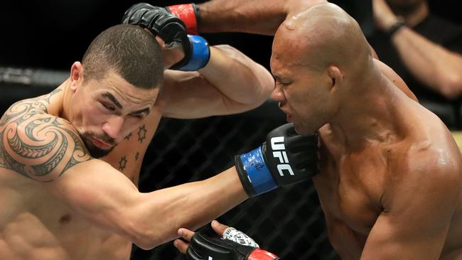 Robert Whittaker's (left) speed was too much for Jacare Souza to handle.