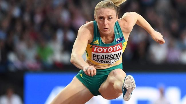 Sally Pearson on her way to a gold medal. Picture: AFP Photo