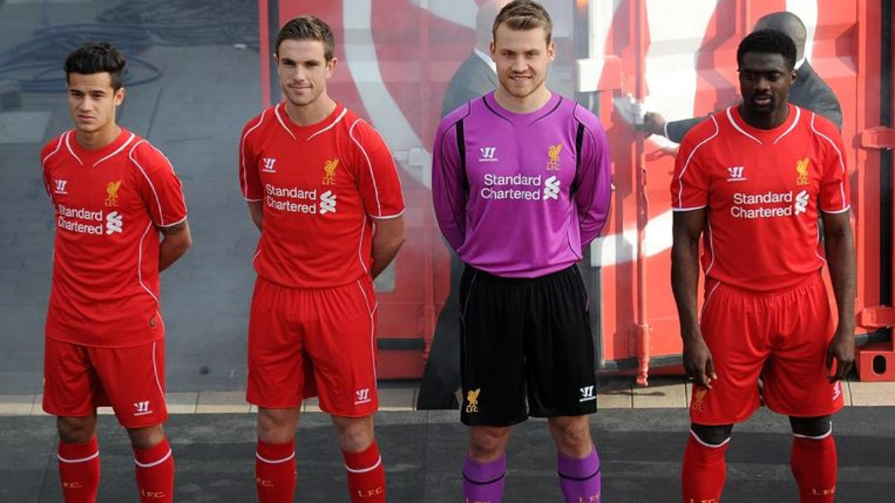 LIVERPOOL, ENGLAND - APRIL 10: (THE SUN OUT, THE SUN ON SUNDAY OUT) Philippe Coutinho, Jordan Henderson, Simon Mignolet and Kolo Toure of Liverpool present the new home kit for next season at Liverpool One on April 10, 2014 in Liverpool, England. (Photo by Andrew Powell/Liverpool FC via Getty Images) *** Local Caption *** Philippe Coutinho;Jordan Henderson;Simon Mignolet;Kolo Toure