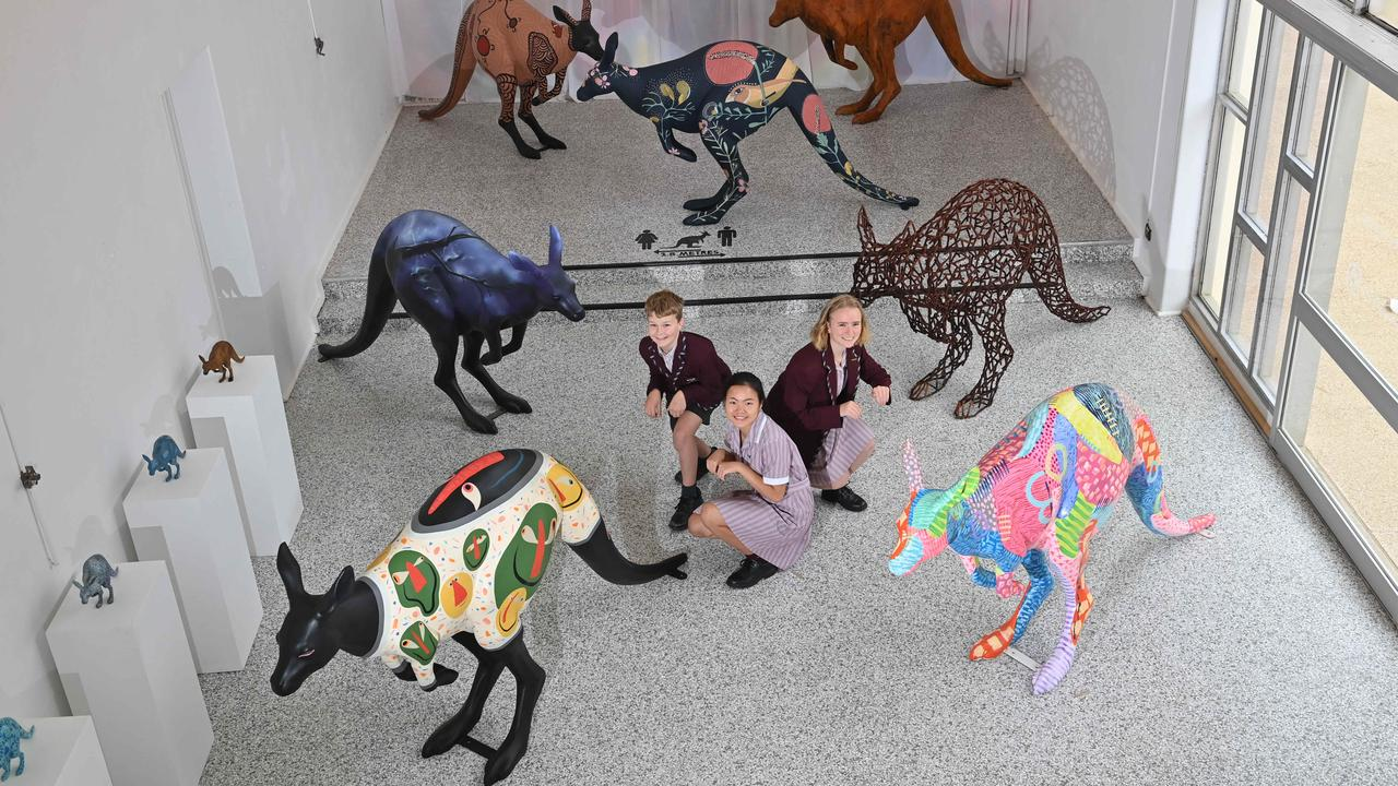 Students Eddie, Jiayi and Millie with some of the kangaroo sculptures at St John's Grammar School, South Australia. Picture: Keryn Stevens