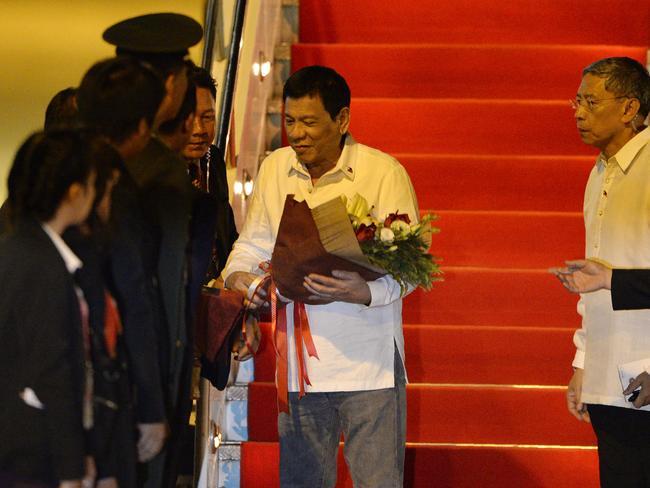 Philippine President Rodrigo Duterte touches down in Laos for the ASEAN Summit. Picture: AFP/Noel Celis