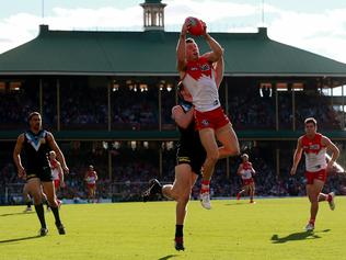 AFL Round 13 - Sydney Swans v Port Adelaide Power at the SCG. Sydney Swans' Harry Cunningham takes a mark in front of his Port Adelaide opponent. Picture: Toby Zerna