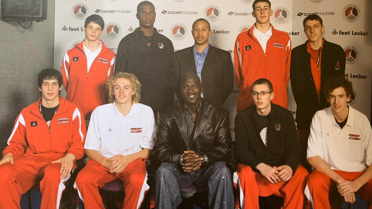 Hugh Greenwood (second from left) sitting next to Michael Jordan. Photo: SEN SA/Twitter