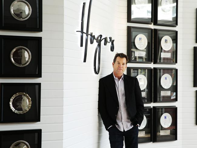 Dave Evans admires the trophies of Hugos Kings Cross, now on the wall in the group's Manly venue, which will remain unaffected by the closure of the Bayswater Rd bar. Picture: Braden Fastier