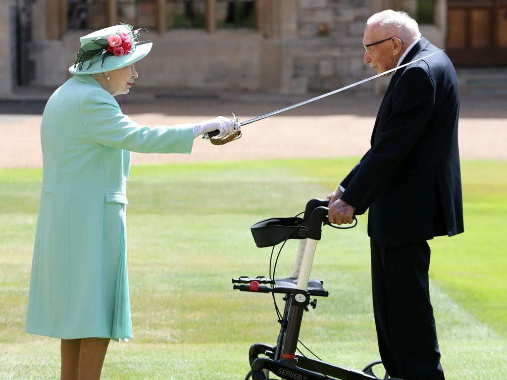 Queen Elizabeth II awards Captain Sir Thomas Moore with the insignia of Knight Bachelor at Windsor Castle. Picture: Chris Jackson/Getty Images