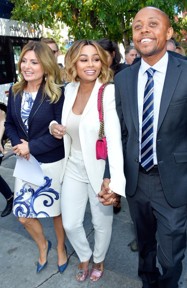 Blac Chyna (centre), pictured with Lisa Bloom and Walter Mosley, has been granted a temporary restraining order against Rob Kardashian. Picture: Matt Winkelmeyer/Getty Images