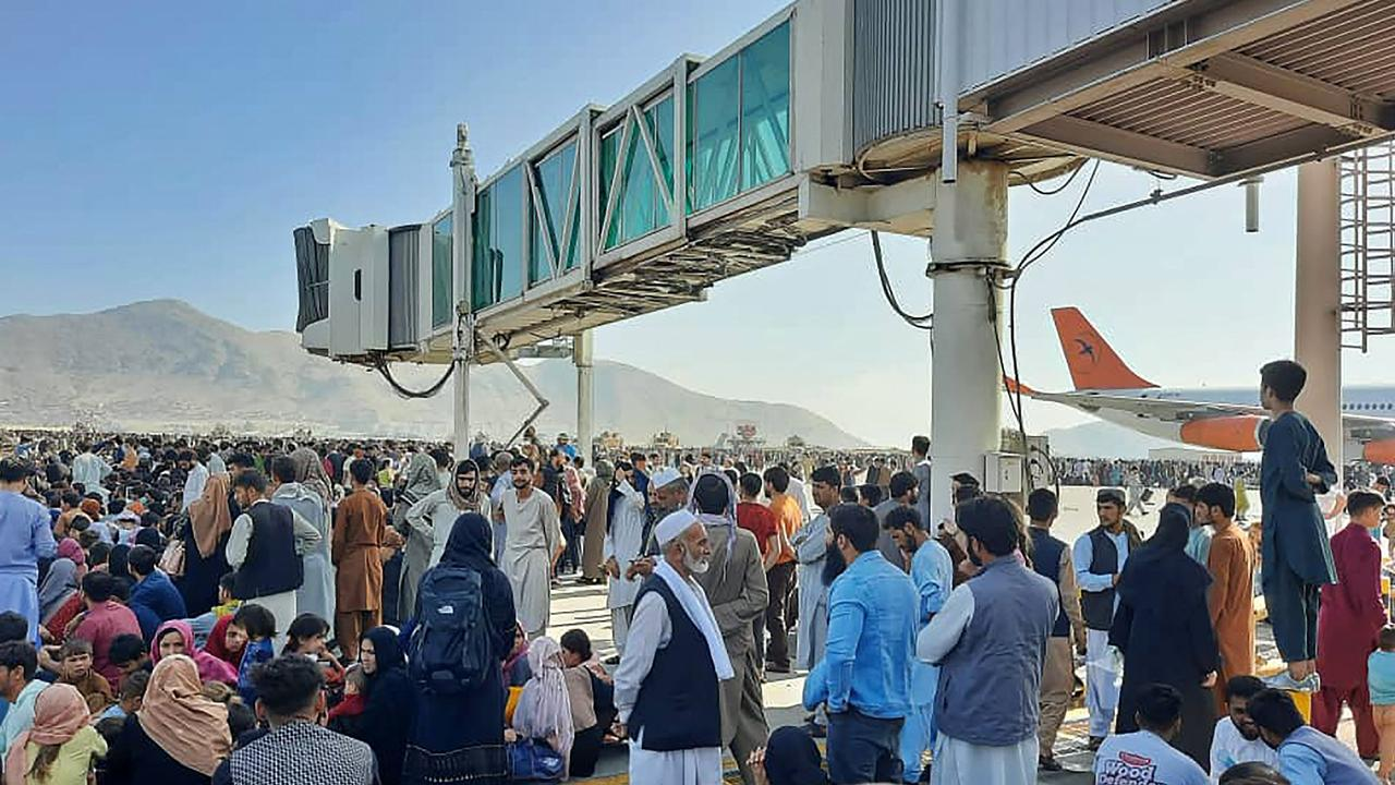 Afghans crowding the tarmac at Kabul Airport wanting to flee the country. Picture: AFP