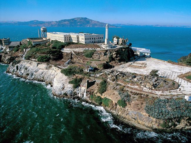 93. ALCATRAZ, SAN FRANCISCO BAY, USA The prison island made famous as the place everyone tried to escape from, is now inundated with visitors wanting to be there. Tours of the abandoned jail (once home to notorious high-profile criminals like Al Capone) include guided walks through the dark decrepit cell blocks, led by former prison staff who have plenty of stories to tell.