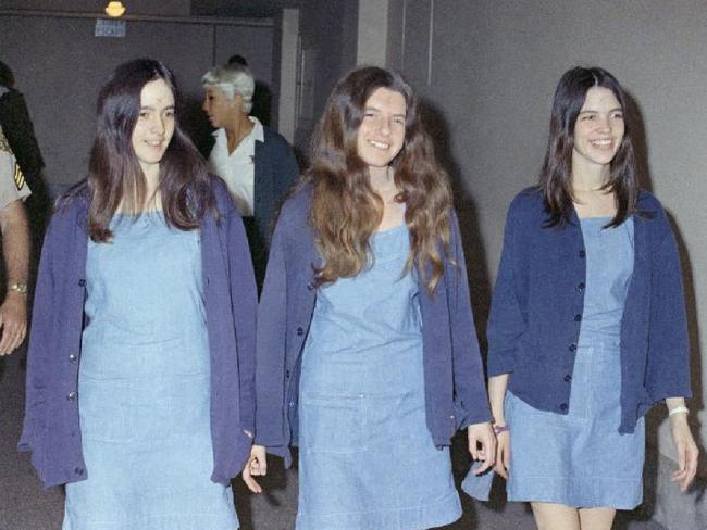 Three of Charles Manson's murderous followers complete with crosses carved in their foreheads, Susan Atkins, Patricia Krenwinkel and Leslie Van Houten before their death sentences. Picture: News Corp.