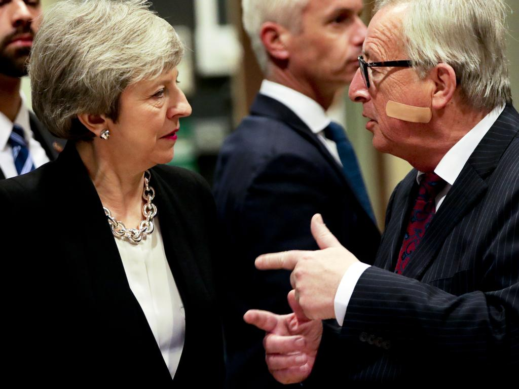 European Commission President Jean-Claude Juncker, right, speaks with British Prime Minister Theresa May who has postponed the Brexit vote. Picture: AP