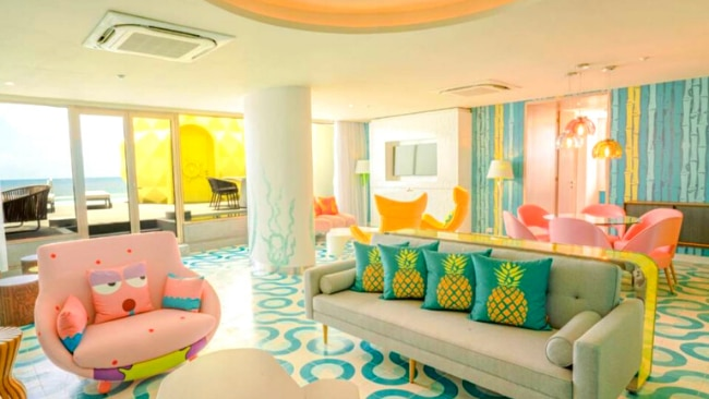 """5/8 The Pineapple Suite will make guests feel like they're under the sea with a floor-to-ceiling """"porthole"""" window, as well as with the infinity rooftop swimming pool."""