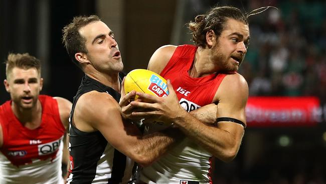 Steele Sidebottom tackle on Jordan Foote was one of 115 the Magpies laid against Sydney. Picture: Getty Images