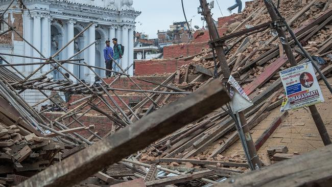 People stand on top of debris from a collapsed building at Basantapur Durbar Square following an earthquake on April 25, 2015 in Kathmandu, Nepal. Picture: Omar Havana/Getty Images