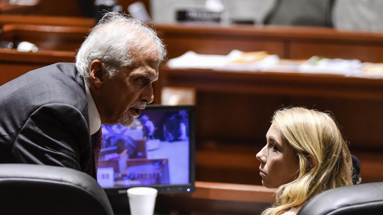 Brooke Skylar Richardson talks to lawyer Charles H. Rittgers. Picture: Nick Graham/The Journal-News via AP