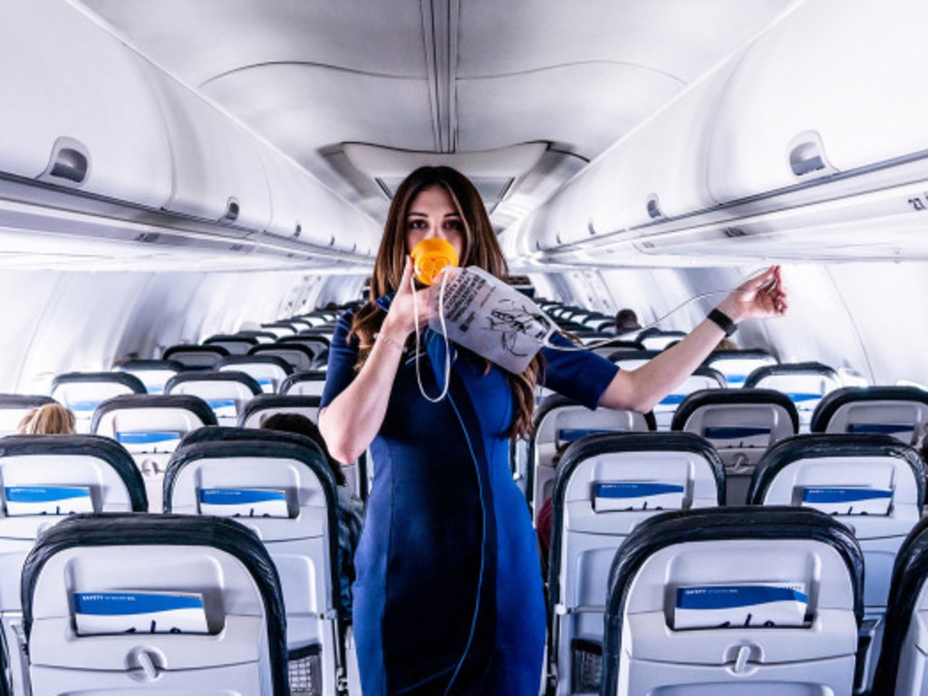 A flight attendant has shared a series of pics showing what it's like flying during the coronavirus pandemic.