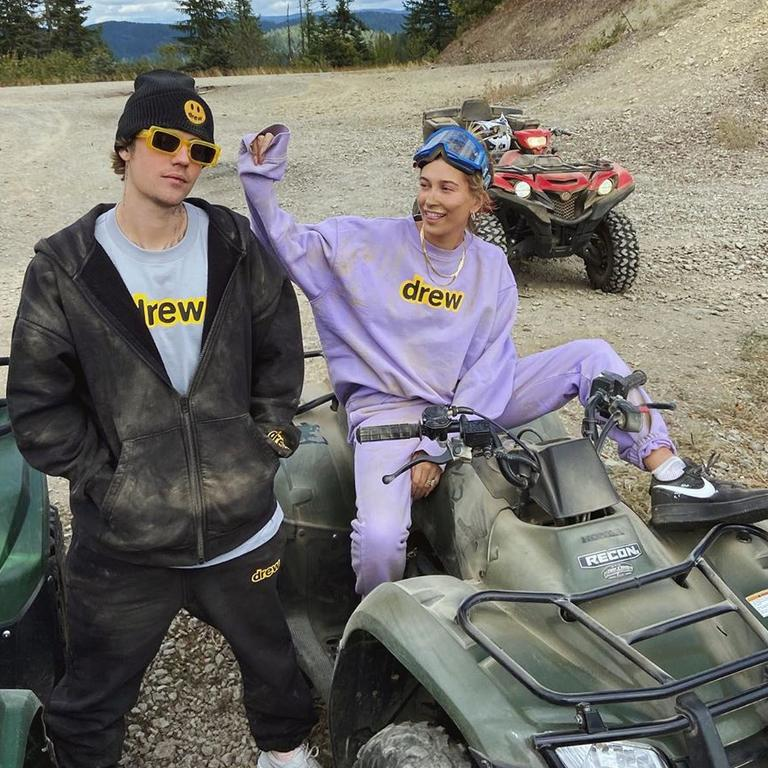 Hailey Baldwin Bieber and Justin Bieber pose in matching outfits after going for a quad bike ride.