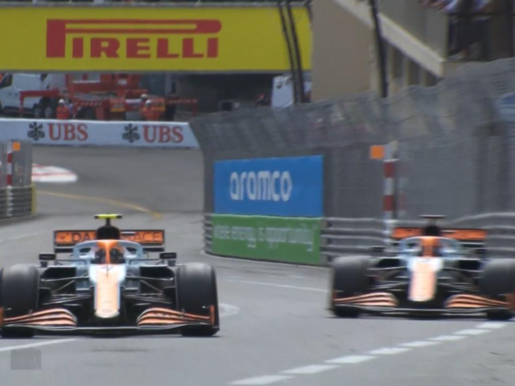 Lando Norris going past Daniel Ricciardo on the overlap.