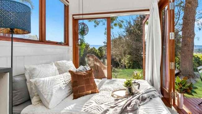 8/146Sixteen The Banks, Agnes BanksThis gorgeous tiny home is situated near the country town of Richmond, NSW. It's set on 5 arable acres, with beautiful views of lush green turf farms, designer horse studs and the Grose Vale with the iconic Blue Mountains as its backdrop. This tiny home oozes personality and has plenty of windows for you to view the stunning surrounds in comfort. You can also relax around the fire pit and indulge in some wine and cheese.