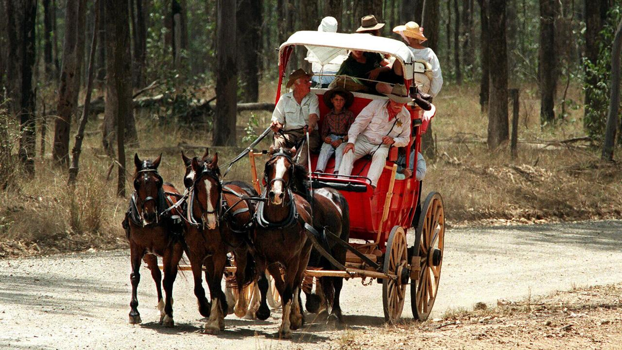 People tourists on Cobb & Co horse and coach for Gympie Gold Rush near Tiaro, Qld. and tourism /Queensland