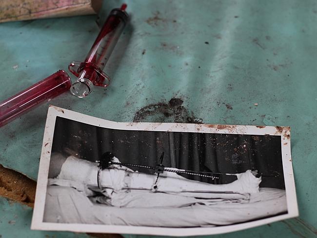 Injury pictures sit alongside syringes.