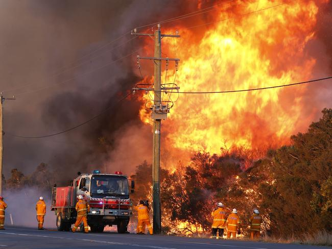 Fire crews backburn areas of bushland at Salt Ash today. Picture: AAP