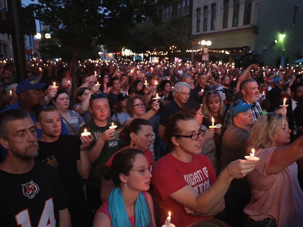 Mourners attend a memorial service in the Oregon District to recognise the victims of the mass shooting in Dayton, Ohio. Picture: Scott Olson/Getty Images/AFP