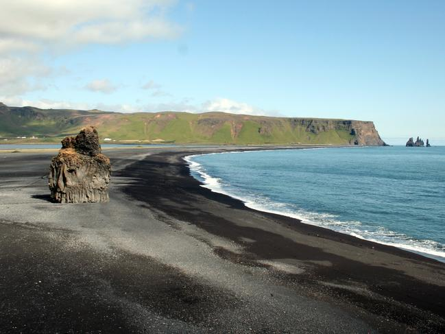 28. REYNISFJARA BEACH, ICELAND   Iceland's Reynisfjara Beach is the broody version of its happy-go-lucky tropical counterparts. Here golden sands are replaced with black pebbles, palm trees with jagged rocks, sand dunes with soaring cliffs, and rolling waves with powerful surges. The result? It is absolutely stunning.