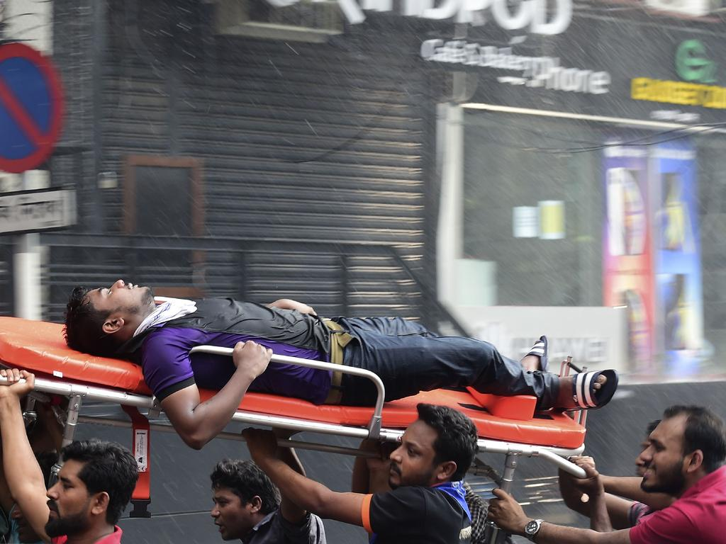 A Bangladeshi survivor is taken to hospital after being rescued by firefighters from a burning office building in Dhaka on March 28, 2019. Picture AFP