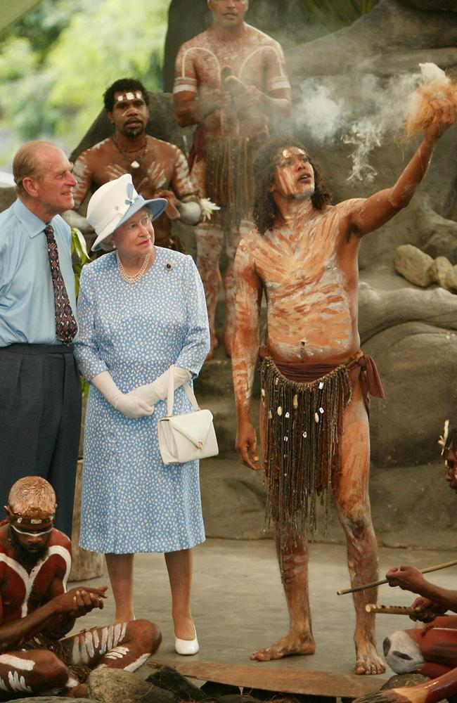 Queen Elizabeth II Prince Philip (L) watch Tjapukai Aborigines light a ceremonial fire during a cultural performance near Cairns in 2002. Picture: AFP