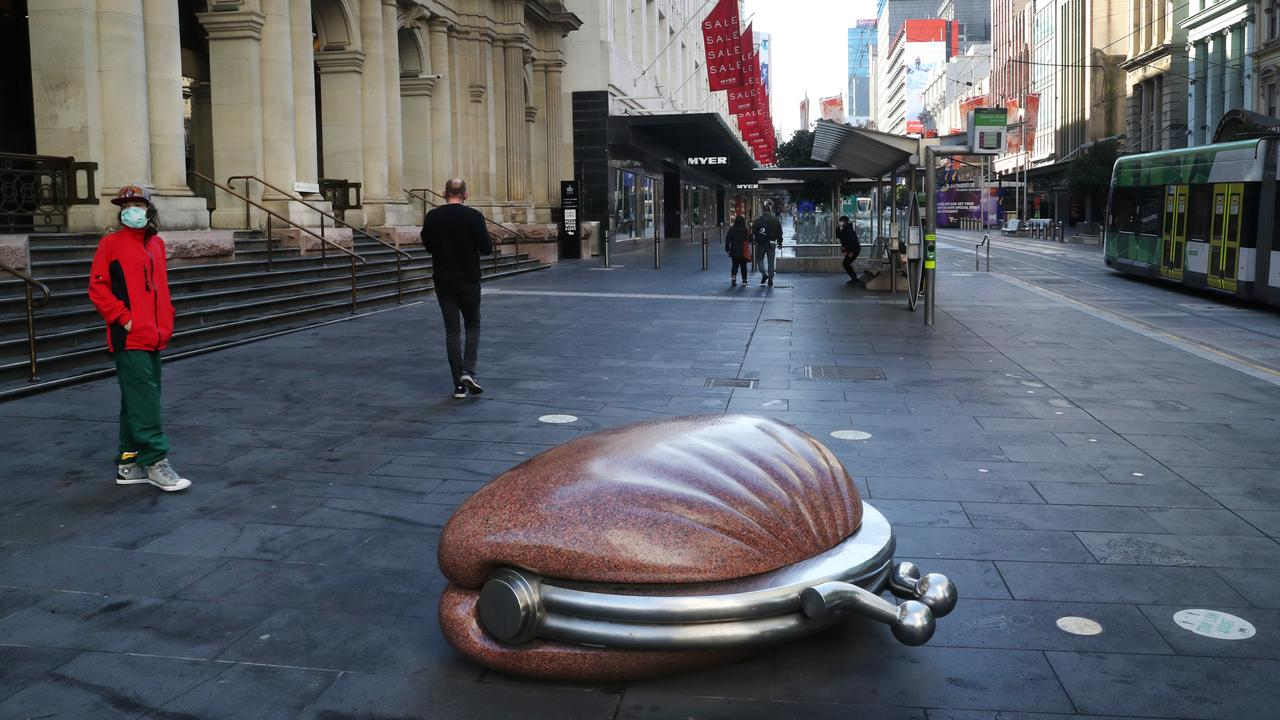 People get their daily exercise in an empty Bourke Street mall this week. Picture: NCA NewsWire / David Crosling