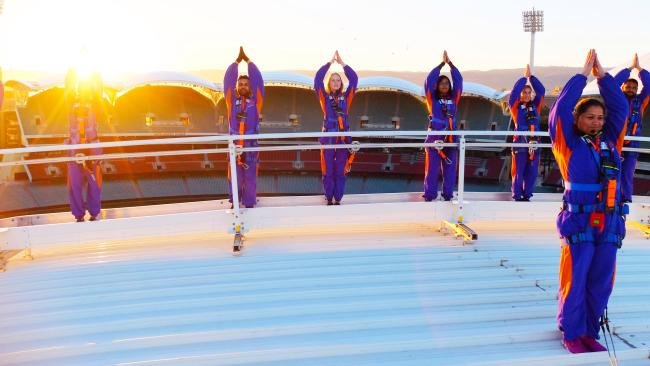 RoofClimb Yoga, Adelaide Oval, SA Salute the sun on a Saturday morning by getting closer to it on the rooftop of the Adelaide Oval. Instead of tights, you'll be suited up and attached to a safety line, then the RoofClimb team will guide you through a unique sequence of asanas while you drink in 360-degree views over the city. Sessions run across summer, kicking off in December, ending with acai bowls and freshly squeezed juice. Picture: Supplied