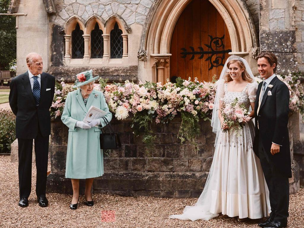 The Queen and Prince Philip pose for a socially distanced photograph at Princess Beatrice's wedding, which went ahead after being postponed because of the coronavirus outbreak. Picture: Benjamin Wheeler
