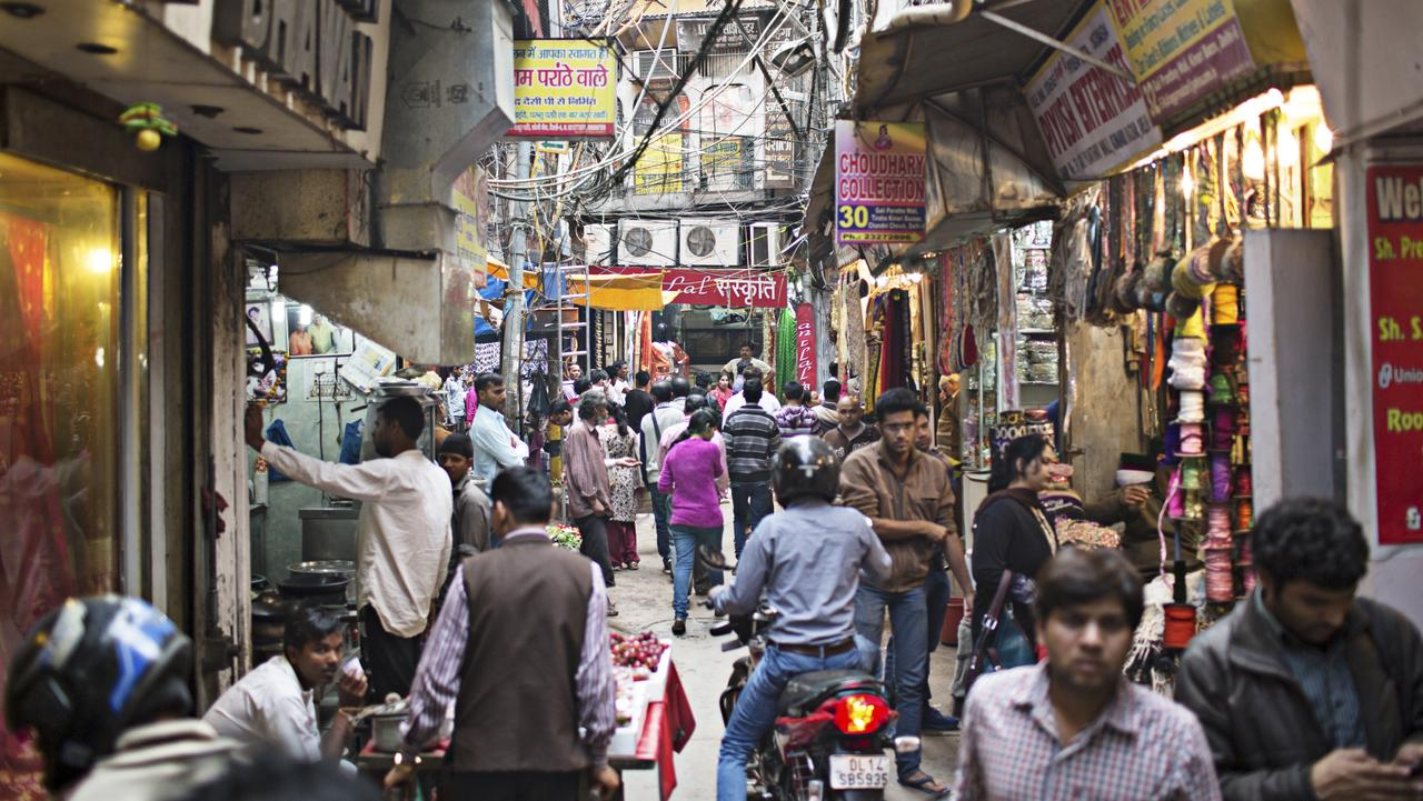 Take the plunge into Old Delhi's frenetic traffic, bazaars and curry shacks.
