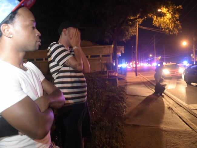 Jermaine Towns and Brandon Shuford wait down the street from Pulse nightclub. Picture: AP Photo/Phelan M. Ebenhack