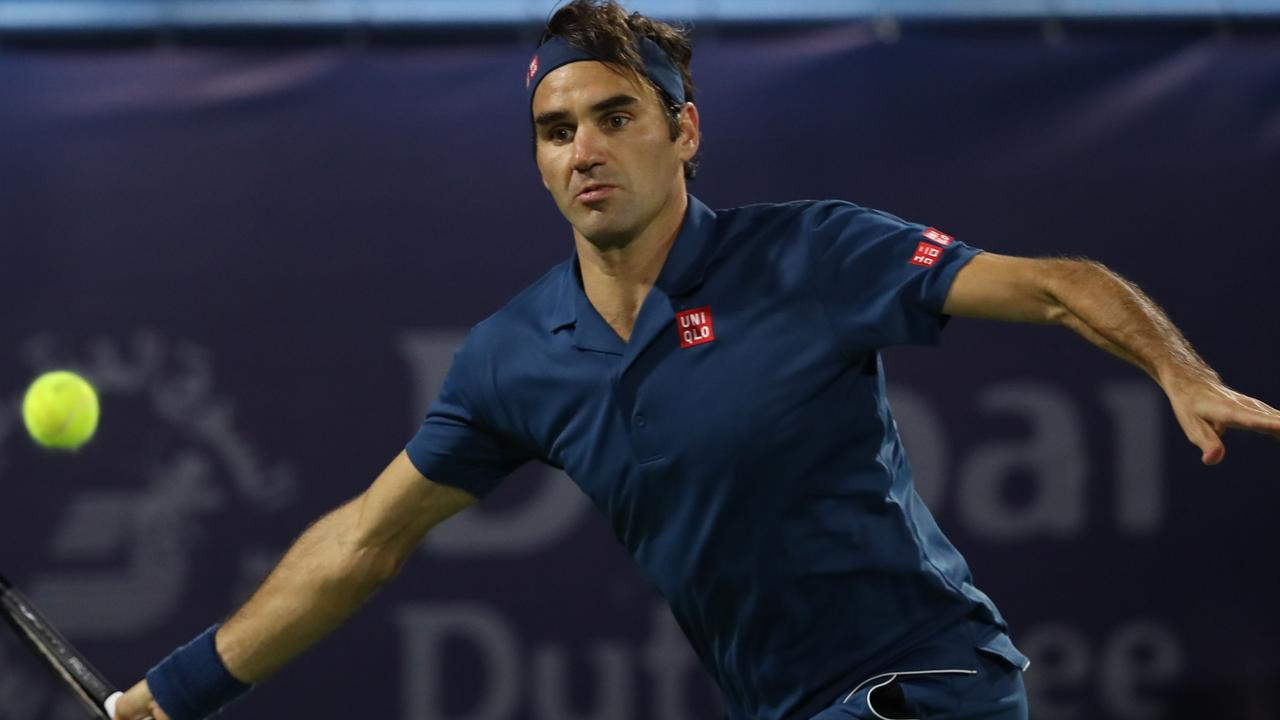 Switzerland's Roger Federer returns the ball to Greece's Stefanos Tsitsipas during the final match at the ATP Dubai Tennis Championship in the Gulf emirate of Dubai on March 2, 2019. - Roger Federer won his 100th career title when he defeated Greece's Stefanos Tsitsipas 6-4, 6-4 in the final of the Dubai Championships. (Photo by KARIM SAHIB / AFP)