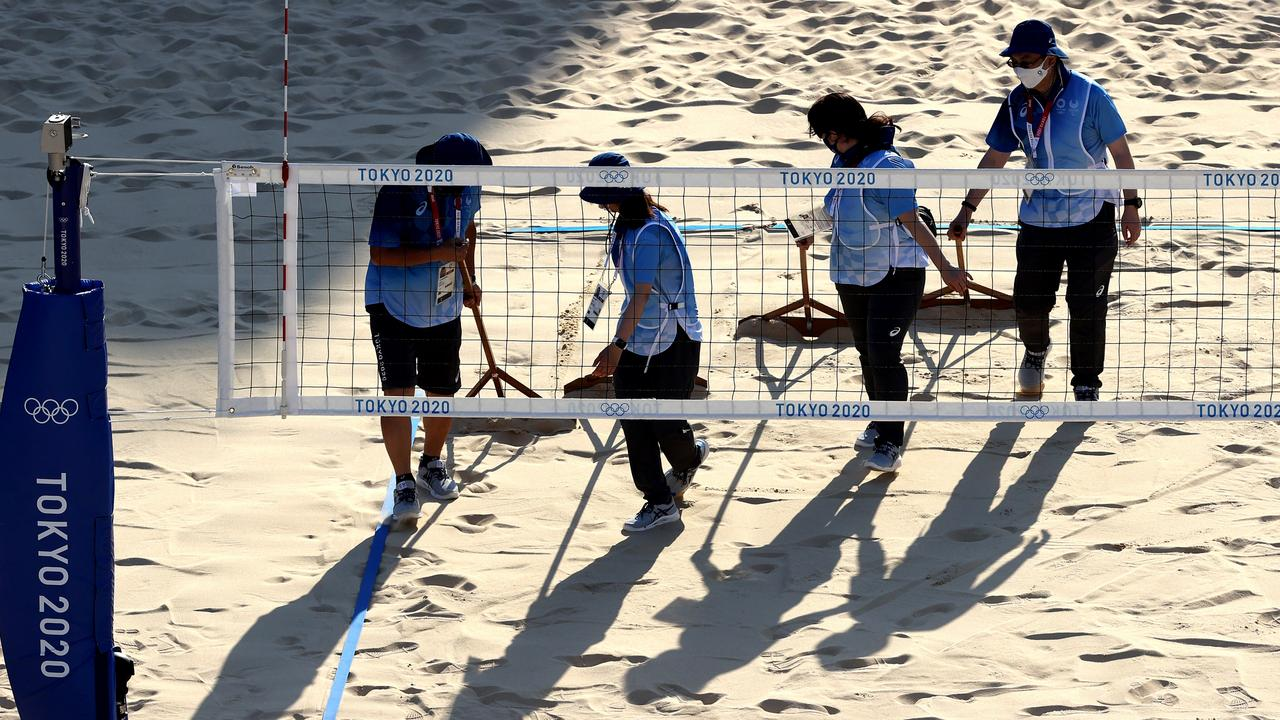 Workers prepare the Beach Volleyball court prior to a training session at Shiokaze Park. Picture: Sean M. Haffey
