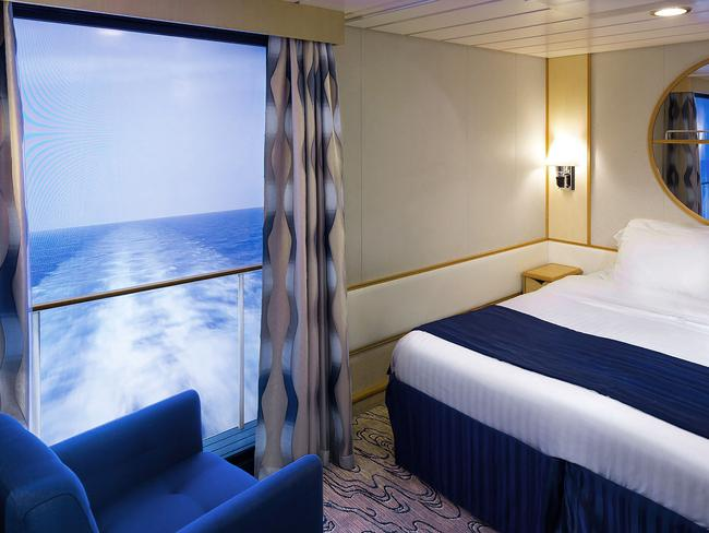 VIRTUAL BALCONIES Don't have a room with a view? Not to worry. Voyager's virtual balconies provide guests in interior staterooms with real-time sights and sounds of the sea displayed on an 80-inch, high-definition screen framed to look like the real thing.