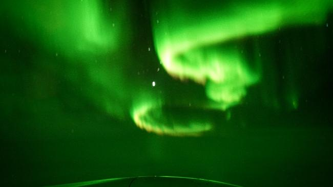 Shades of green light up the cabin window. Picture: Jeremy Drake