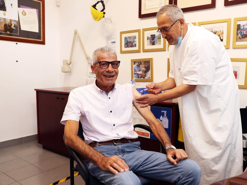 Dr Jamal Rifi administers a COVID-19 vaccine at Belmore Medical Centre. Picture: Tim Hunter