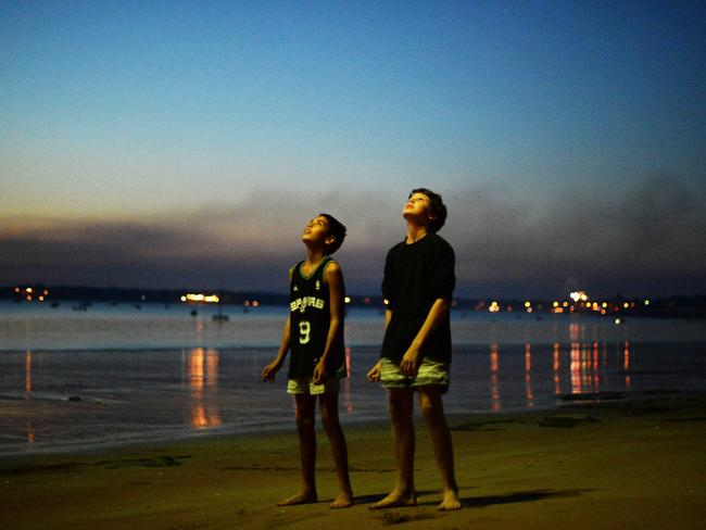 A classic NT scene: Kids, a peaceful beach and exploding stuff in the sky.
