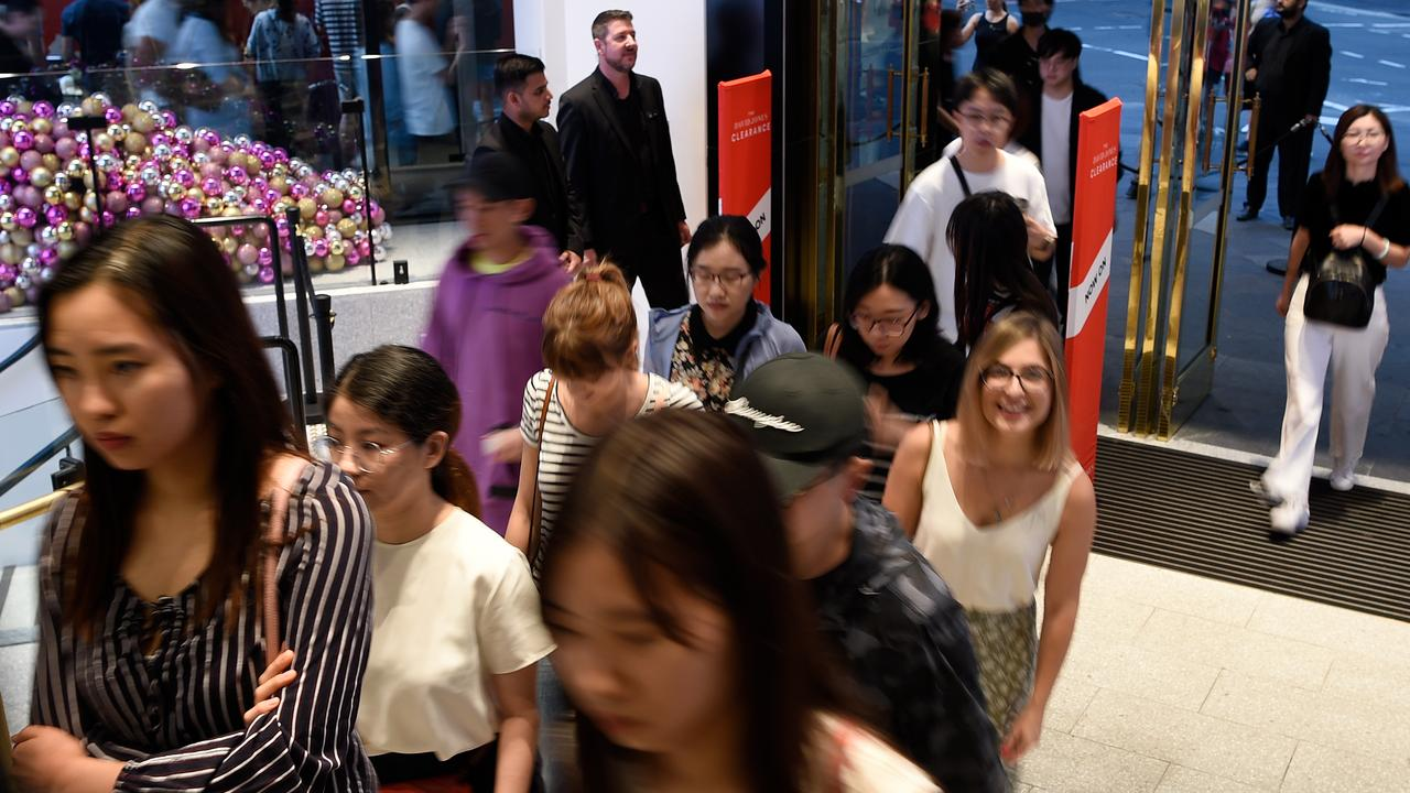 The first shoppers stream into David Jones in the Sydney CBD on Boxing Day 2019. Picture: Bianca De Marchi