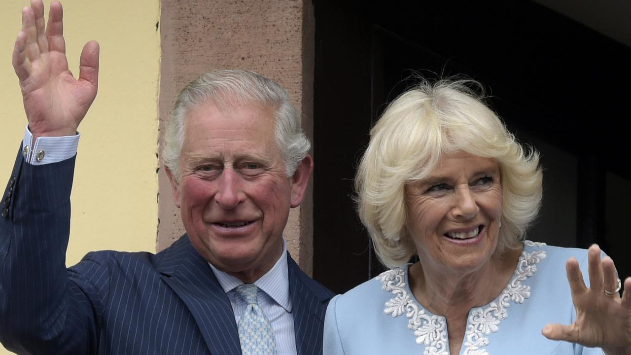 Britain's Prince Charles and Camilla, Duchess of Cornwall wave from the town hall balcony in Leipzig, Germany. Prince Charles has tested positive for the coronavirus. AP Photo/Jens Meyer.