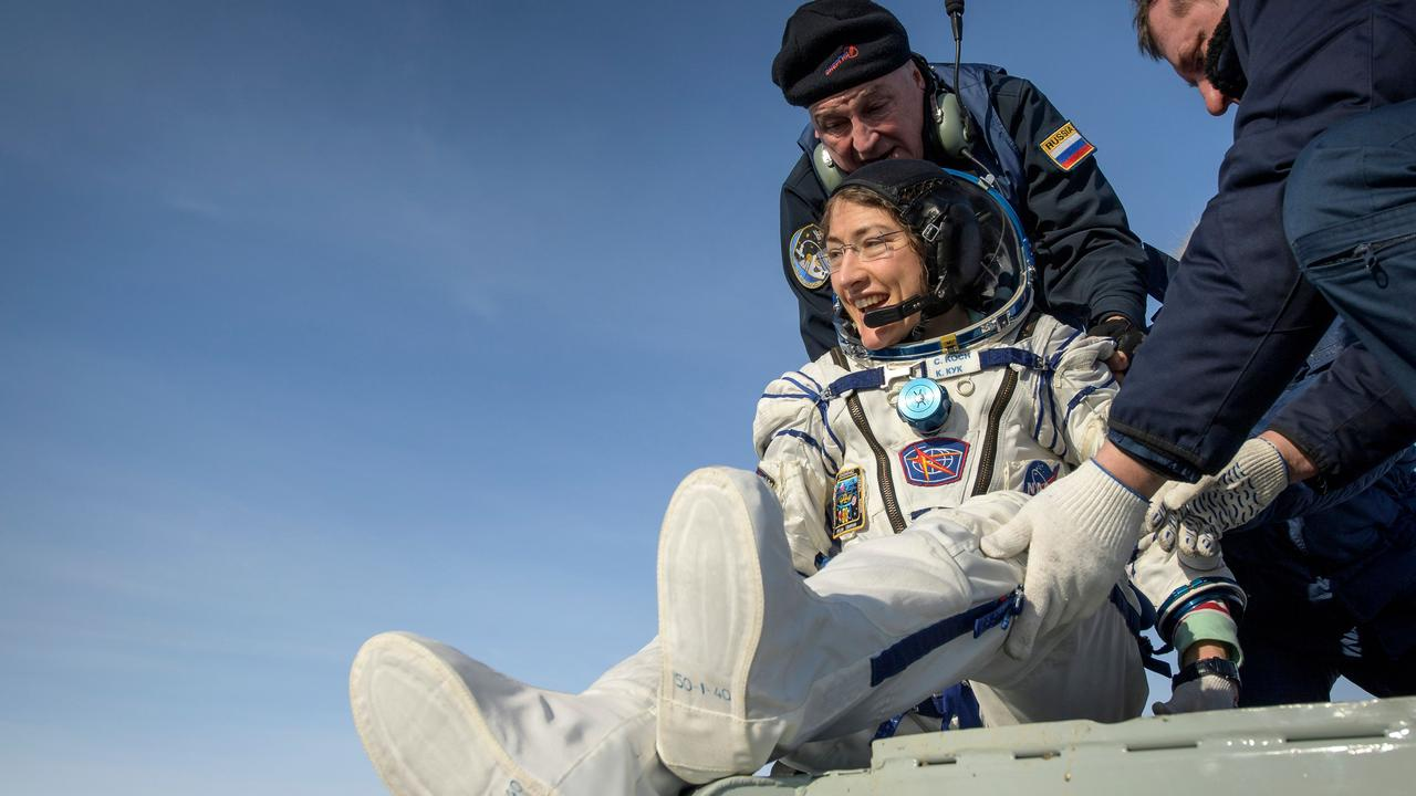 NASA astronaut Christina Koch as she is helped out of the space capsule on Friday. Picture: Bill INGALLS / NASA / AFP